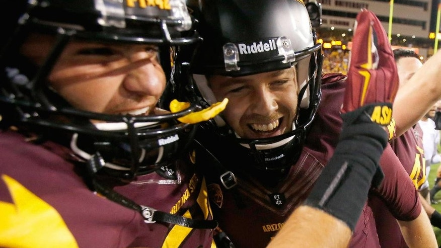 Arizona State's Zane Gonzalez, right, smiles as he celebrates his game-winning field goal against Utah with teammate Shane Till, left, after overtime in an NCAA college football game on Saturday, Nov. 1, 2014, in Tempe, Ariz.  Arizona State defeated the Utah 19-16 in overtime. (AP Photo/Ross D. Franklin)