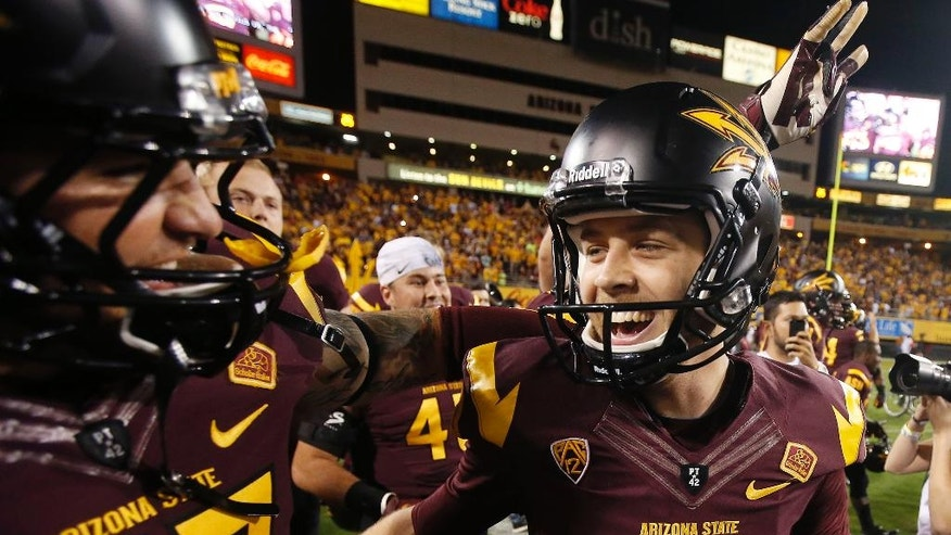 Arizona State's Zane Gonzalez (5) smiles as he celebrates his game-winning field goal against Utah with teammate Shane Till, left, after overtime in an NCAA college football game on Saturday, Nov. 1, 2014, in Tempe, Ariz.  Arizona State defeated the Utah 19-16 in overtime. (AP Photo/Ross D. Franklin)