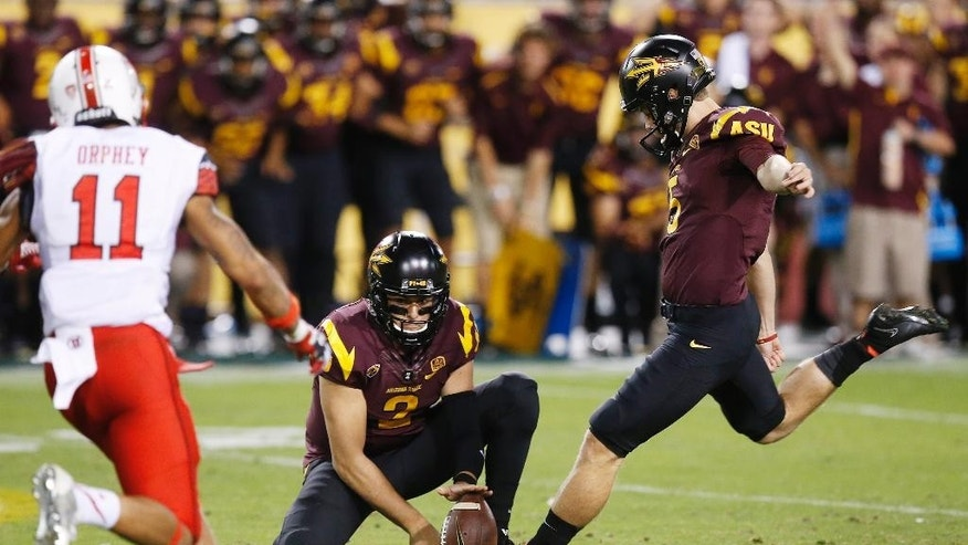 Arizona State's Zane Gonzalez, right, gets ready to kick the game-winning field goal as teammate Mike Bercovici (2) holds the ball as Utah's Davion Orphey (11) looks on in overtime of an NCAA college football game on Saturday, Nov. 1, 2014, in Tempe, Ariz.  Arizona State defeated the Utah 19-16 in overtime. (Photo/Ross D. Franklin)