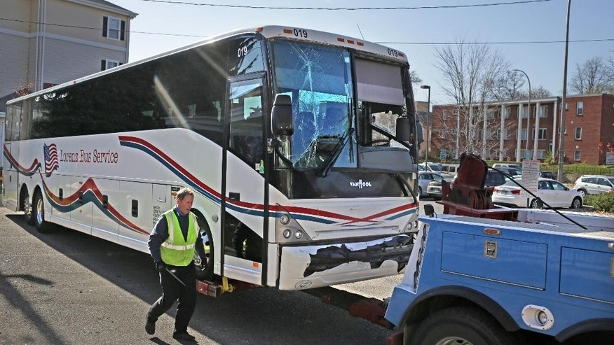 Tom Lynch of Twins Cities Towing and Recovery prepares one of two buses involved in an earlier accident for towing, Sunday, Nov. 2, 2014.  Two Washington Redskins team buses collided about 8:15 a.m. Sunday morning on their way to the NFL game vs. the Minnesota Vikings, along eastbound Interstate 94 at the ramp to Huron Ave. Minor injuries were reported, authorities said, but the REdskins said no one on the team was injured.  (AP Photo/The Star Tribune, David Denney)  MANDATORY CREDIT; ST. PAUL PIONEER PRESS OUT; MAGS OUT; TWIN CITIES LOCAL TELEVISION OUT