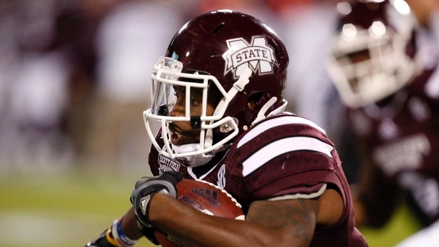 Mississippi State running back Josh Robinson (13) runs for a first down in the first half of an NCAA college football game against Arkansas in Starkville, Miss., Saturday, Nov. 1, 2014. (AP Photo/Rogelio V. Solis)