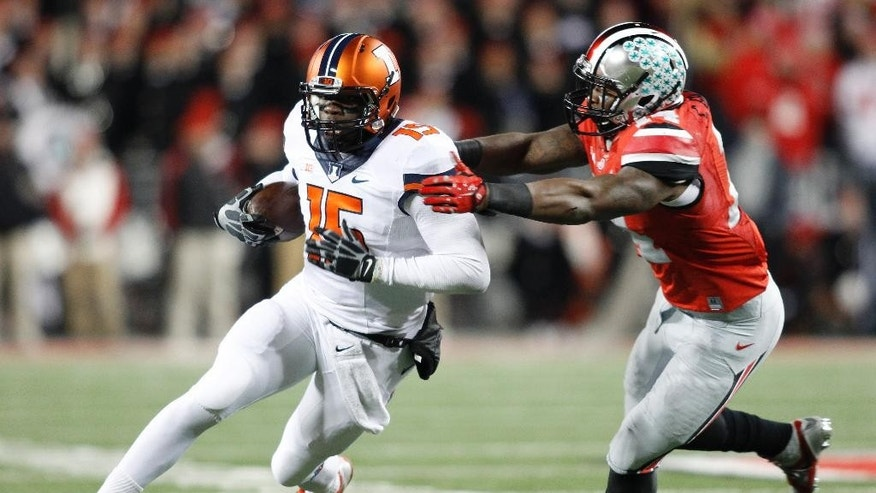 Illinois quarterback Aaron Bailey tries to outrun Ohio State linebacker Curtis Grant during the second quarter of an NCAA college football game Saturday, Nov. 1, 2014, in Columbus, Ohio. (AP Photo/Paul Vernon)