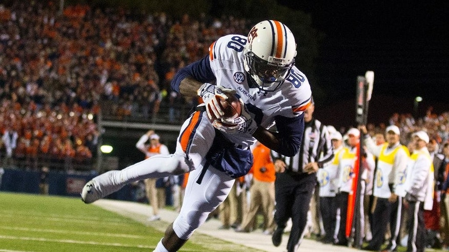 Auburn wide receiver Marcus Davis scores a touchdown during the second half of an NCAA college football game against Mississippi, Saturday, Nov. 1, 2014, in Oxford, Miss. Auburn won 35-31. (AP Photo/Brynn Anderson)