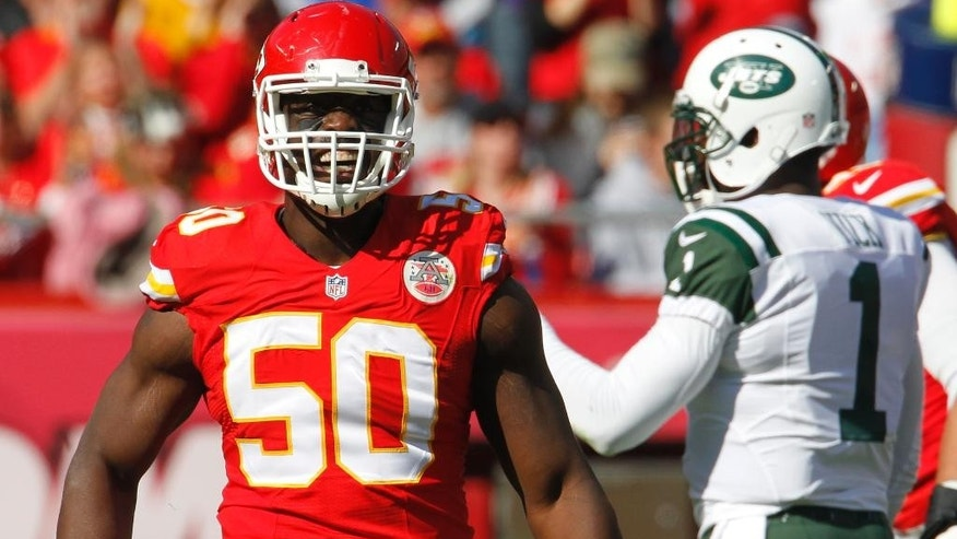 Kansas City Chiefs outside linebacker Justin Houston (50) reacts after a sacking of New York Jets quarterback Michael Vick (1) in the first half of an NFL football game in Kansas City, Mo., Sunday, Nov. 2, 2014. (AP Photo/Colin E. Braley)