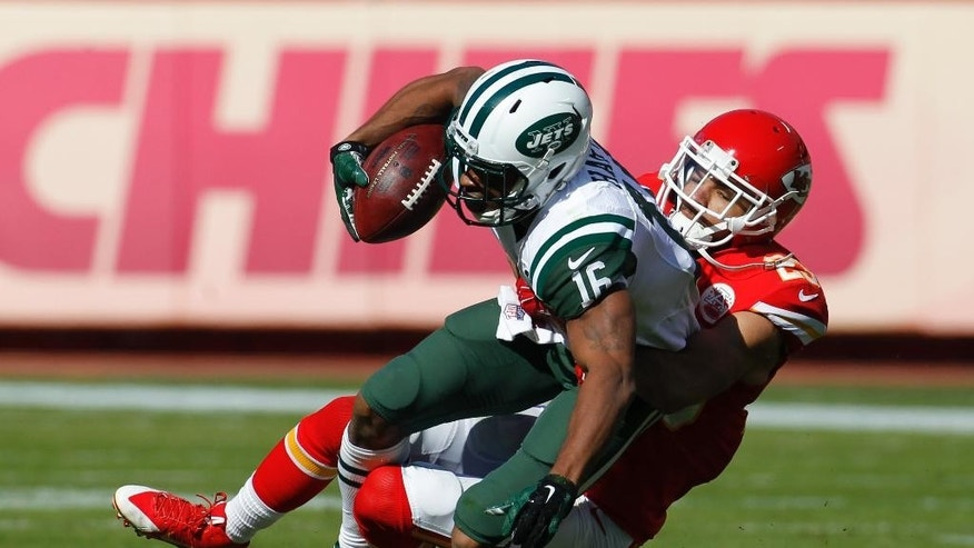 New York Jets wide receiver Percy Harvin (16) is dragged down by Kansas City Chiefs cornerback Phillip Gaines (23) in the first half of an NFL football game in Kansas City, Mo., Sunday, Nov. 2, 2014. (AP Photo/Colin E. Braley)