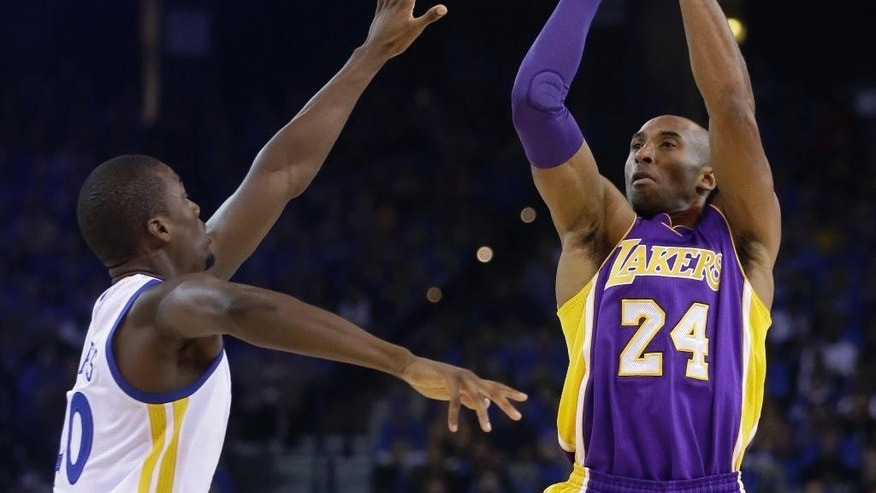 Los Angeles Lakers' Kobe Bryant (24) shoots over Golden State Warriors' Harrison Barnes during the first half of an NBA basketball game Saturday, Nov. 1, 2014, in Oakland, Calif. (AP Photo/Ben Margot)