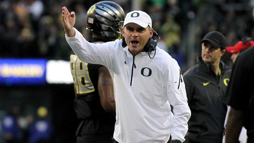 Oregon head coach Mark Helfrich yells at the referee during the second quarter against Stanford in an NCAA college football game in Eugene, Ore., Saturday, Nov. 1, 2014. (AP Photo/Ryan Kang)