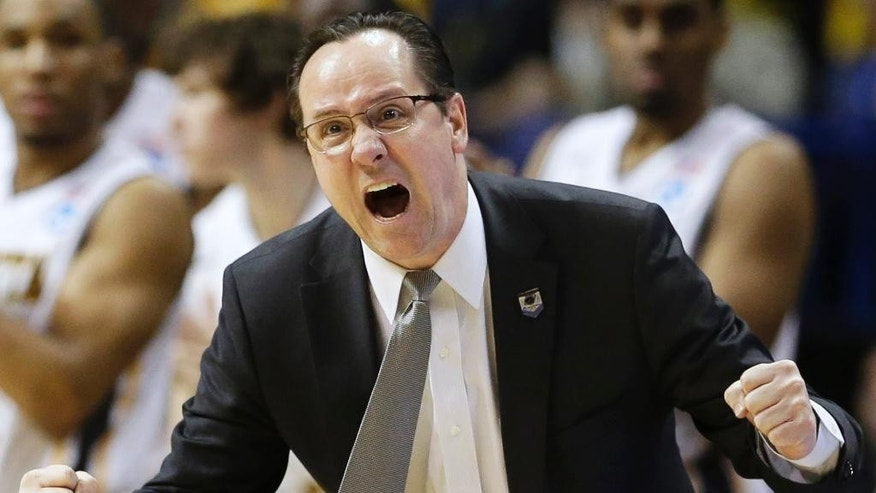 FILE - In this March 23, 2014 file photo, Wichita State head coach Gregg Marshall encourages his team during the second half of a third-round game against Kentucky at the NCAA college basketball tournament in St. Louis. After a perfect regular season ended with an ouster at the hands of Kentucky as a No. 1 seed in the NCAA tournament, No. 11 Wichita State is ready to begin pursuit of another Final Four. (AP Photo/Charlie Riedel, File)
