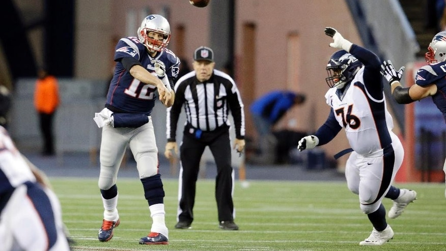 New England Patriots quarterback Tom Brady (12) passes in front of the rush of Denver Broncos defensive tackle Marvin Austin (76) in the first half of an NFL football game on Sunday, Nov. 2, 2014, in Foxborough, Mass. (AP Photo/Stephan Savoia)