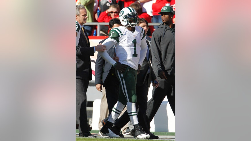 New York Jets quarterback Michael Vick (1) leaves the field after an injury in the second half of an NFL football game against the Kansas City Chiefs in Kansas City, Mo., Sunday, Nov. 2, 2014. (AP Photo/Colin E. Braley)