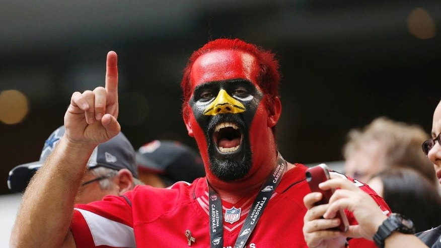 An Arizona Cardinals fan shows his support during the second half of an NFL football game against the Dallas Cowboys Sunday, Nov. 2, 2014, in Arlington, Texas.  Arizona won the game 28-17.  (AP Photo/Sue Ogrocki)