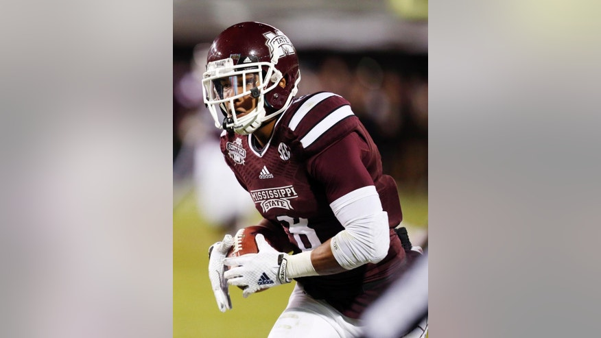 Mississippi State wide receiver Fred Ross (8) runs upfield for a 69-yard touchdown pass reception in the second half of an NCAA college football game against Arkansas in Starkville, Miss., Saturday, Nov. 1, 2014. No. 1 Mississippi State won 17-10. (AP Photo/Rogelio V. Solis)