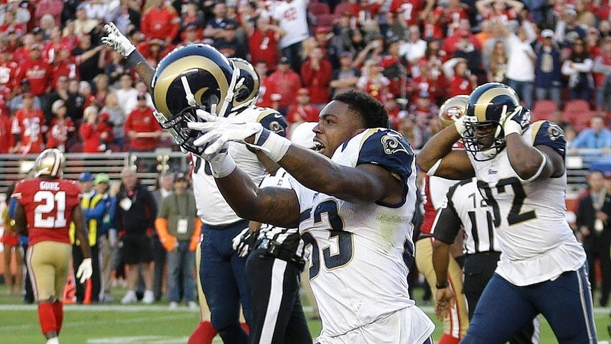 St. Louis Rams linebacker Daren Bates (53) celebrates after the Rams recovered a fumble by San Francisco 49ers quarterback Colin Kaepernick during the fourth quarter of an NFL football game in Santa Clara, Calif., Sunday, Nov. 2, 2014. The Rams won 13-10. (AP Photo/Ben Margot)