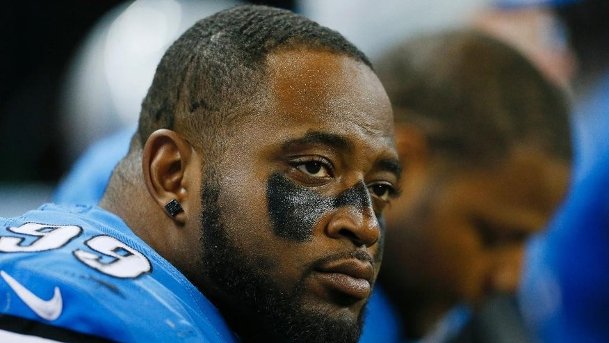 FILE - In this Oct. 19, 2014, file photo, Detroit Lions defensive tackle C.J. Mosley sits on the bench during the second half of an NFL football game against the New Orleans Saints in Detroit. Mosley was sent home from the team's trip to London and suspended for Detroit's game against Atlanta on Oct. 26 for an unspecified violation of team rules. The Lions have activated him off the reserve-suspended by club list, and he made a statement Monday, Nov. 3, 2014. (AP Photo/Rick Osentoski, File)