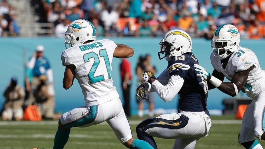 Miami Dolphins cornerback Brent Grimes (21) intercepts a pass intended for San Diego Chargers wide receiver Keenan Allen (13) during the second half of an NFL football game, Sunday, Nov. 2, 2014, in Miami Gardens, Fla. To the right is Miami Dolphins free safety Michael Thomas (31).  (AP Photo/Lynne Sladky)