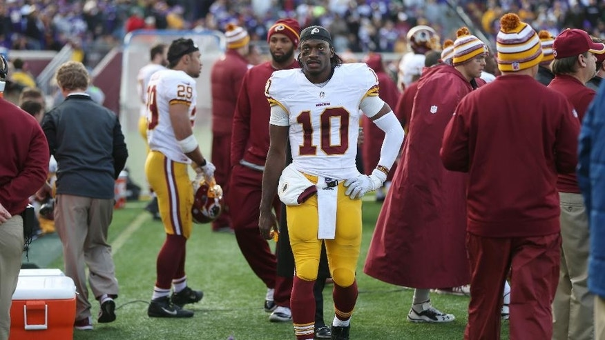 Washington Redskins quarterback Robert Griffin III walks on the sidelines at the end of an NFL football game against the Minnesota Vikings, Sunday, Nov. 2, 2014, in Minneapolis. The Vikings won 29-26. (AP Photo/Jim Mone)