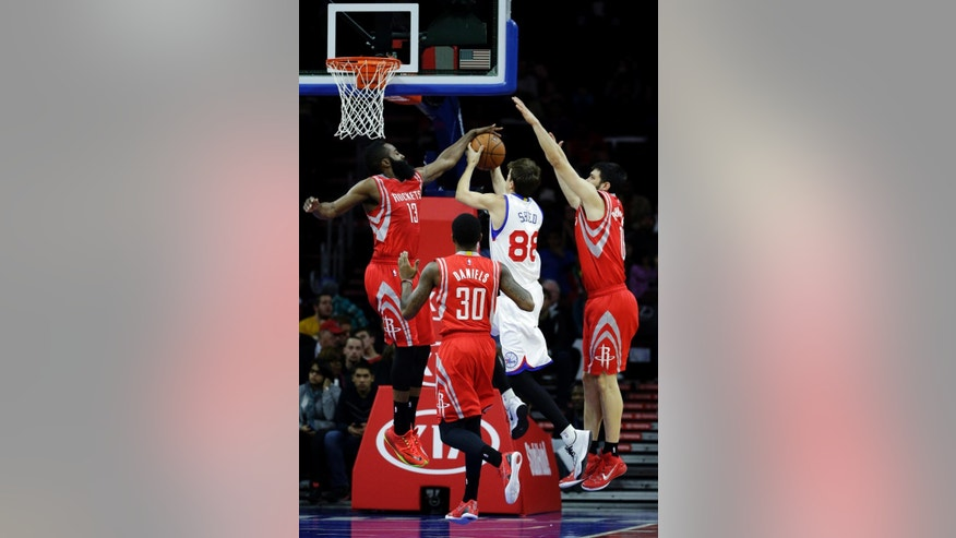 Philadelphia 76ers' Alexey Shved (88), of Russia, cannot get a shot past Houston Rockets' James Harden (13), Kostas Papanikolaou (16), of Greece, and Troy Daniels (30) during the first half of an NBA basketball game, Monday, Nov. 3, 2014, in Philadelphia. (AP Photo/Matt Slocum)
