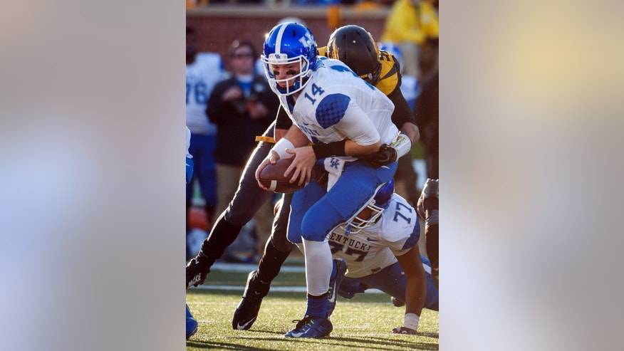Kentucky quarterback Patrick Towles, left, is sacked by Missouri's Shane Ray during the third quarter of an NCAA college football game Saturday, Nov. 1, 2014, in Columbia, Mo. (AP Photo/L.G. Patterson)