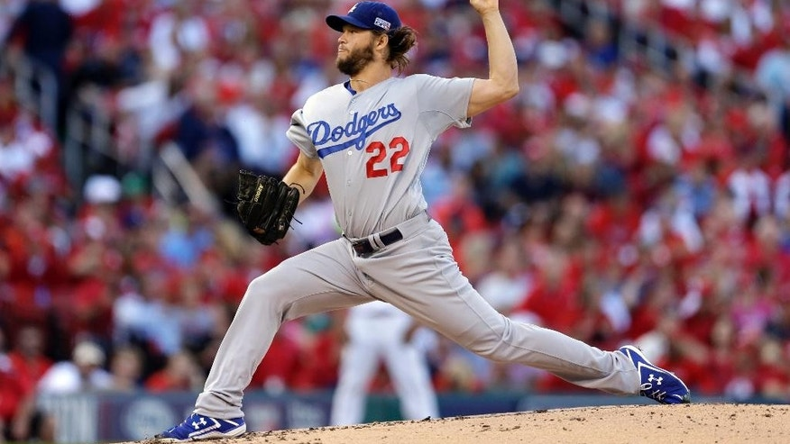 FILE - In this Oct. 7, 2014, file photo, Los Angeles Dodgers starting pitcher Clayton Kershaw throws a pitch during the second inning of Game 4 of baseball's NL Division Series against the St. Louis Cardinals in St. Louis. Kershaw has been voted the player of the year in balloting by his fellow major leaguers. The players' union said Monday, Nov. 3, that Kershaw also won the Marvin Miller Man of the Year award. (AP Photo/Jeff Roberson, File)