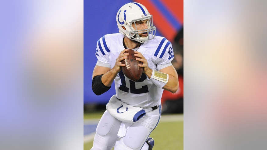 Indianapolis Colts quarterback Andrew Luck looks to pass during the first half of an NFL football game against the New York Giants, Monday, Nov. 3, 2014, in East Rutherford, N.J.  (AP Photo/Bill Kostroun)