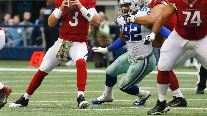 Arizona Cardinals quarterback Carson Palmer (3) drops back to pass against the Dallas Cowboys during the first half of an NFL football game Sunday, Nov. 2, 2014, in Arlington, Texas. (AP Photo/Sue Ogrocki)
