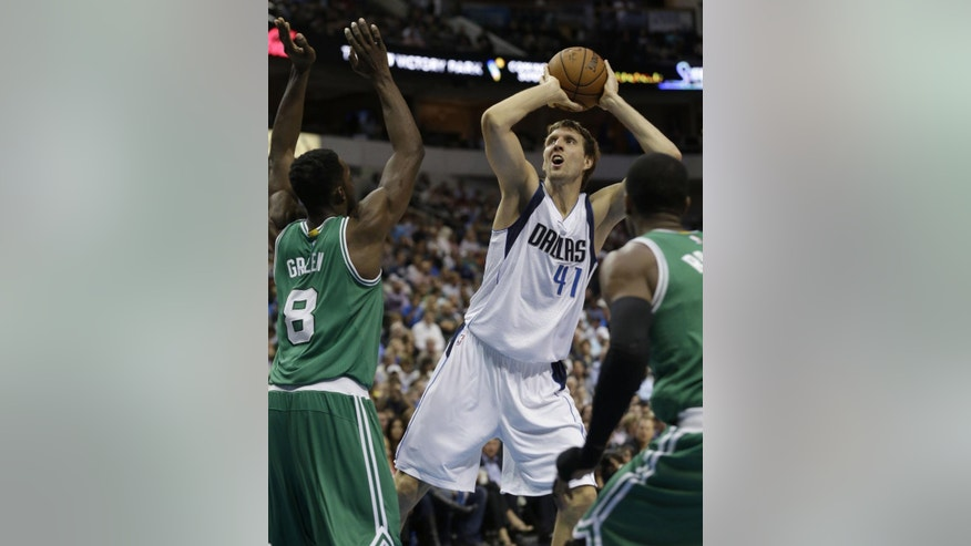 Dallas Mavericks forward Dirk Nowitzki (41) of Germany shoots against Boston Celtics forward Jeff Green (8) during the first half of an NBA basketball game in Dallas, Monday, Nov. 3, 2014. (AP Photo/LM Otero)