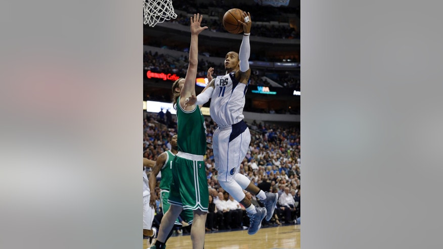 Dallas Mavericks guard Monta Ellis (11) drives to the basket against Boston Celtics center Kelly Olynyk (41) during the first half of an NBA basketball game in Dallas, Monday, Nov. 3, 2014. (AP Photo/LM Otero)