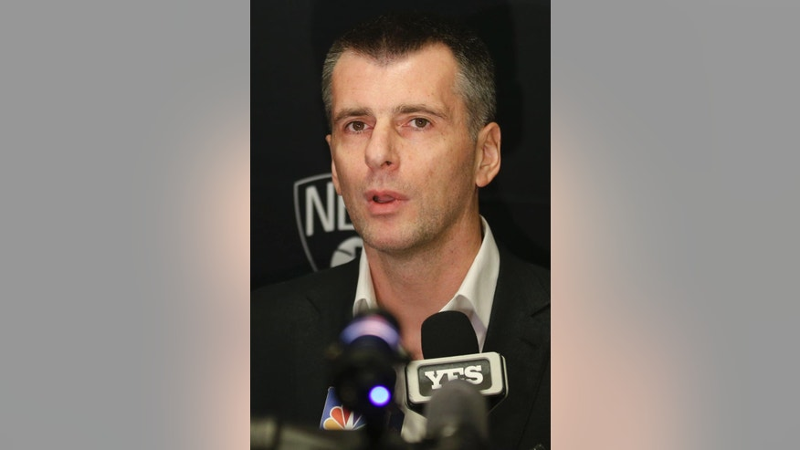 Mikhail Prokhorov, owner of the Brooklyn Nets, speaks to the media during a news conference before an NBA basketball game between the Nets and the Oklahoma City Thunder at the Barclays Center, Monday, Nov. 3, 2014, in New York. (AP Photo/John Minchillo)