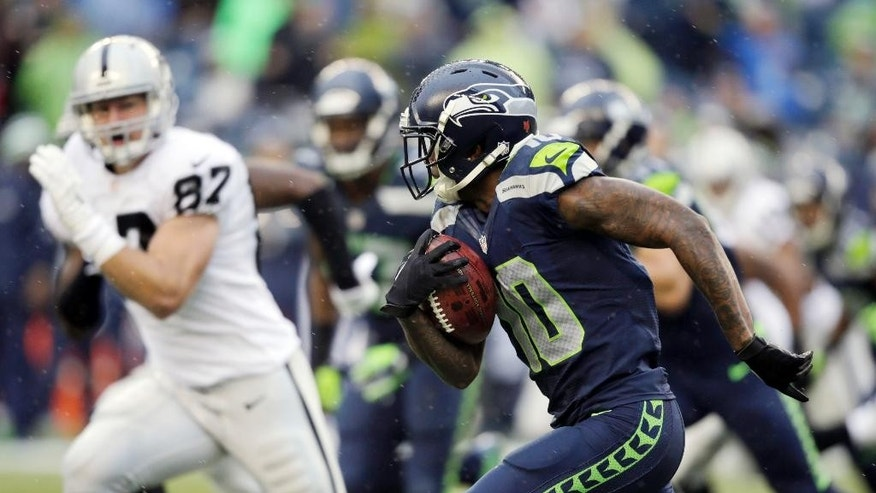 Seattle Seahawks wide receiver Paul Richardson, right, runs the ball against the Oakland Raiders in the second half of an NFL football game, Sunday, Nov. 2, 2014, in Seattle. (AP Photo/Stephen Brashear)