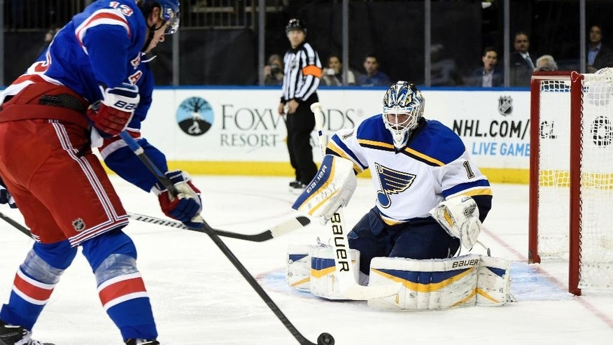 St. Louis Blues goalie Brian Elliott (1) blocks a shot on goal by New York Rangers right wing Kevin Hayes (13) in the second period of an NHL hockey game at Madison Square Garden on Monday, Nov. 3, 2014, in New York. (AP Photo/Kathy Kmonicek)
