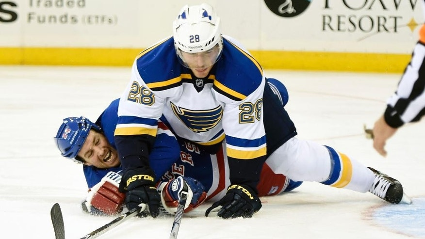New York Rangers left wing Ryan Malone and St. Louis Blues defenseman Ian Cole (28) collide on the ice in the second period of an NHL hockey game at Madison Square Garden on Monday, Nov. 3, 2014, in New York. (AP Photo/Kathy Kmonicek)