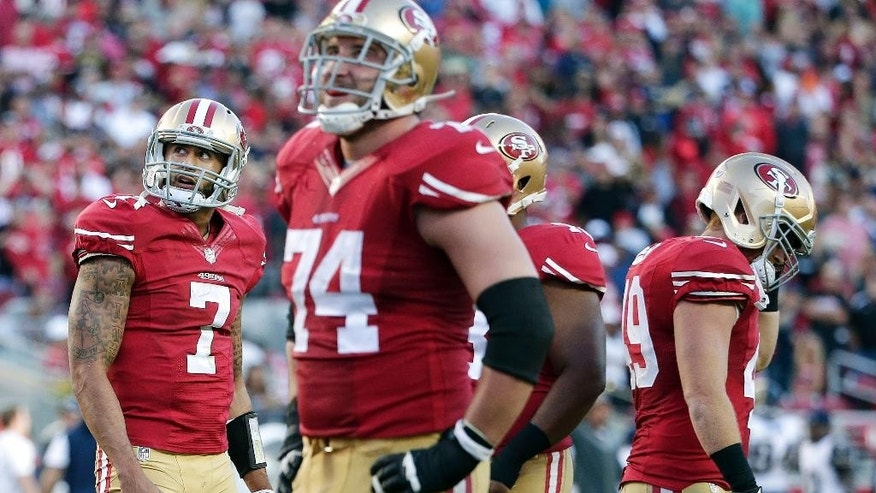 San Francisco 49ers quarterback Colin Kaepernick (7) and offensive tackle Joe Staley (74) react after Kaepernick lost a fumble against the St. Louis Rams during the fourth quarter of an NFL football game in Santa Clara, Calif., Sunday, Nov. 2, 2014. The Rams won 13-10. (AP Photo/Marcio Jose Sanchez)