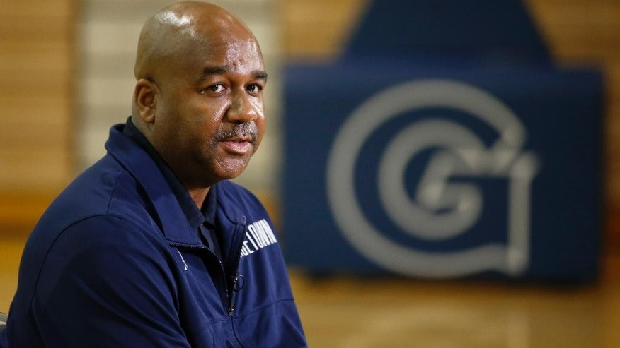 Head coach John Thompson III pauses during a media availability during Georgetown University basketball media day, Thursday, Oct. 23, 2014, in Washington. (AP Photo/Alex Brandon)