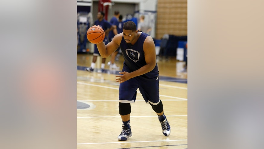 Joshua Smith dribbles the ball during practice during Georgetown University basketball media day, Thursday, Oct. 23, 2014, in Washington. (AP Photo/Alex Brandon)
