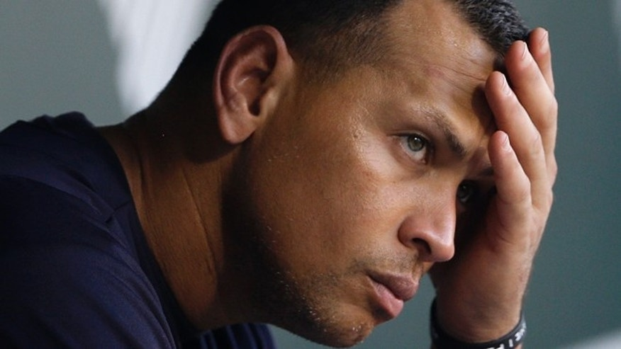Sept. 11, 2013: New York Yankees' Alex Rodriguez wipes sweat from his brow as he sits in the dugout before a baseball game against the Baltimore Orioles in Baltimore.