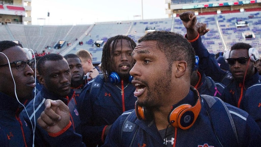 Auburn linebacker Kris Frost leads the team in an inspirational speech before an NCAA college football game against Mississippi, Saturday, Nov. 1, 2014, in Oxford, Miss. (AP Photo/Brynn Anderson)