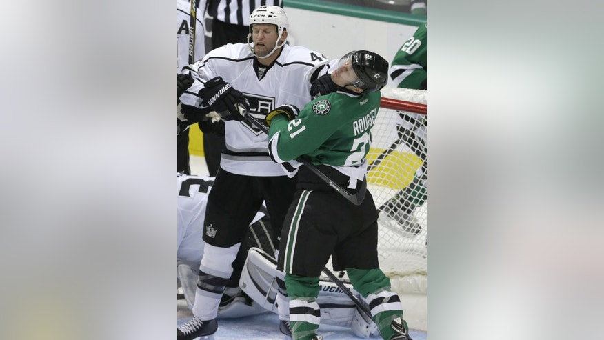 Los Angeles Kings defenseman Robyn Regehr (44) and Dallas Stars left wing Antoine Roussel (21) mix it up during the second period of an NHL hockey game Tuesday, Nov. 4, 2014, in Dallas. (AP Photo/LM Otero)
