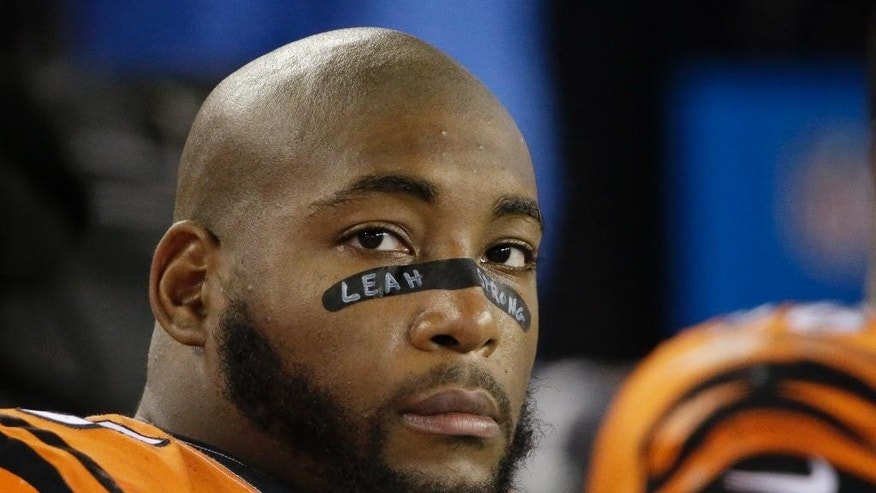 FILE - In this Oct. 5, 2014, file photo, Cincinnati Bengals defensive tackle Devon Still (75) watches the offensive unit perform against the New England Patriots in the second half of an NFL football game in Foxborough, Mass.The Bengals defensive tackle will have his 4-year-old daughter, Leah, watching from a seat at Paul Brown Stadium on Thursday night, Nov. 6, 2014,  when Cincinnati (5-2-1) hosts the Cleveland Browns (5-3). The girl is being treated for cancer. (AP Photo/Stephan Savoia, File)