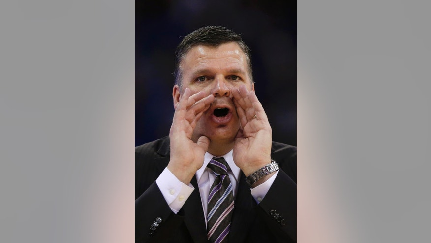FILe - In this file photo from Feb. 23, 2014, Creighton coach Greg McDermott yells instructions in the first half of an NCAA college basketball game against Seton Hall in Omaha, Neb. Creighton is starting over. National player of the year Doug McDermott and three others who helped lead Creighton to a school-record 107 wins the last four years are gone, and now the Bluejays are picked near the bottom of the Big East. (AP Photo/Nati Harnik)