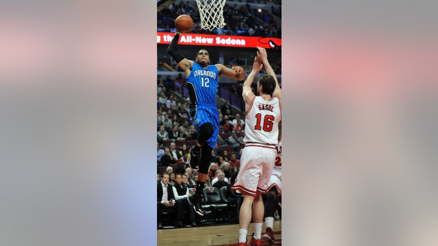Orlando Magic's Tobias Harris (12), goes up for a dunk against Chicago Bulls' Pau Gasol (16), of Spain, during the first half of an NBA basketball game in Chicago, Tuesday, Nov. 4, 2014. (AP Photo/Paul Beaty)