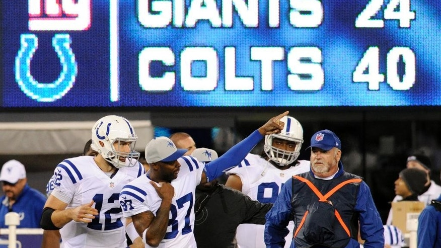 Indianapolis Colts quarterback Andrew Luck (12) and Reggie Wayne (87) react during the second half of an NFL football game against the New York Giants, Monday, Nov. 3, 2014, in East Rutherford, N.J. The Colts won 40-24. (AP Photo/Bill Kostroun)