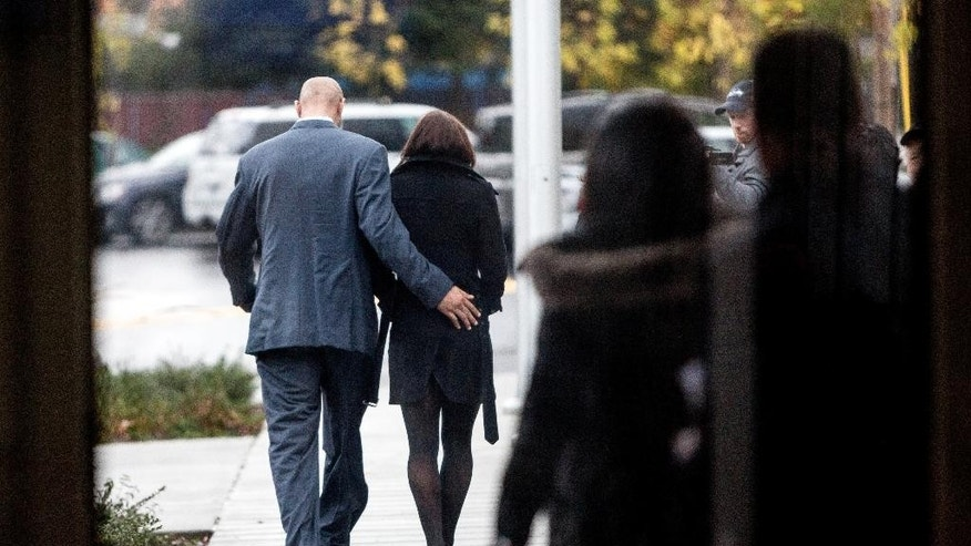 U.S. women's soccer star Hope Solo, center, and her husband, former  Seattle Seahawks football player Jerramy Stevens, left, walk out of at Kirkland Municipal Court Tuesday, Nov. 4, 2014, in Kirkland, Wash. The Seattle Times reports Kirkland Municipal Court Judge Michael Lambo set a Jan. 6 trial date on misdemeanor domestic violence charges for Solo during a brief hearing Tuesday. (AP Photo/seattlepi.com,  Jordan Stead))  MAGS OUT; NO SALES; SEATTLE TIMES OUT; TV OUT; MANDATORY CREDIT