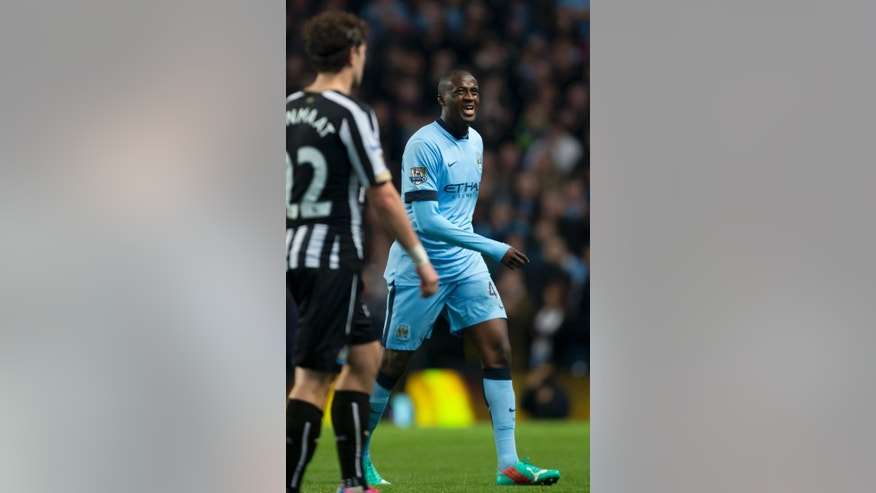 Manchester City's Yaya Toure grimaces as he walks from the pitch after being substituted as his team are beaten 2-0 by Newcastle during the English League Cup soccer match between Manchester City and Newcastle at the Etihad Stadium, Manchester, England, Wednesday Oct. 29, 2014. (AP Photo/Jon Super)