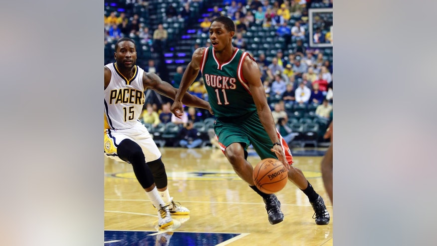 Milwaukee Bucks guard Brandon Knight (11) drives to the basket past Indiana Pacers guard Donald Sloan during the first half of an NBA basketball game in Indianapolis, Tuesday, Nov. 4, 2014. Milwaukee won 87-81. (AP Photo/R Brent Smith)