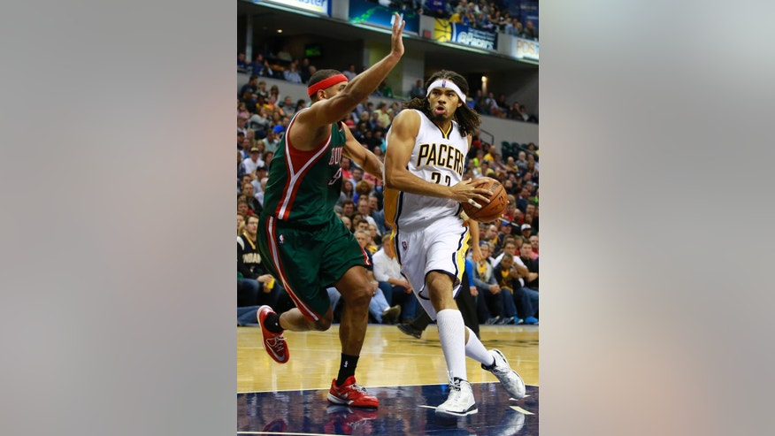 Indiana Pacers forward Chris Copeland drives to the basket as Milwaukee Bucks guard Jerryd Bayless defends during the second half of an NBA basketball game in Indianapolis, Tuesday, Nov. 4, 2014. Milwaukee won 87-81.  (AP Photo/R Brent Smith)