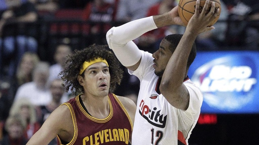 Portland Trail Blazers forward LaMarcus Aldridge, right, looks to pass as Cleveland Cavaliers center Anderson Varejao, from Brazil, defends during the first half of an NBA basketball game in Portland, Ore., Tuesday, Nov. 4, 2014.(AP Photo/Don Ryan)