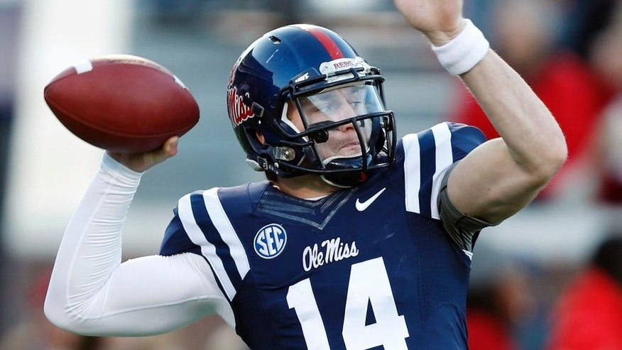 Mississippi quarterback Bo Wallace practices before an NCAA college football game against Auburn, Saturday, Nov. 1, 2014, in Oxford, Miss. (AP Photo/Brynn Anderson)