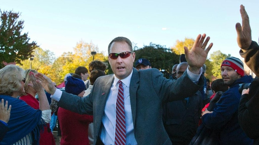 Mississippi head coach Hugh Freeze leads the team through the Walk of Champions before an NCAA college football game against Auburn, Saturday, Nov. 1, 2014, in Oxford, Miss. (AP Photo/Brynn Anderson)
