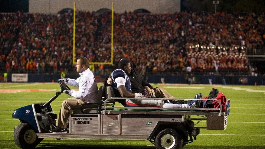 Mississippi wide receiver Laquon Treadwell (1) is taken off the field after being injured during the end of the second half of an NCAA college football game, Saturday, Nov. 1, 2014, in Oxford, Miss. Treadwell fumbled the ball at the Auburn goal line. Auburn won 35-31. (AP Photo/Brynn Anderson)