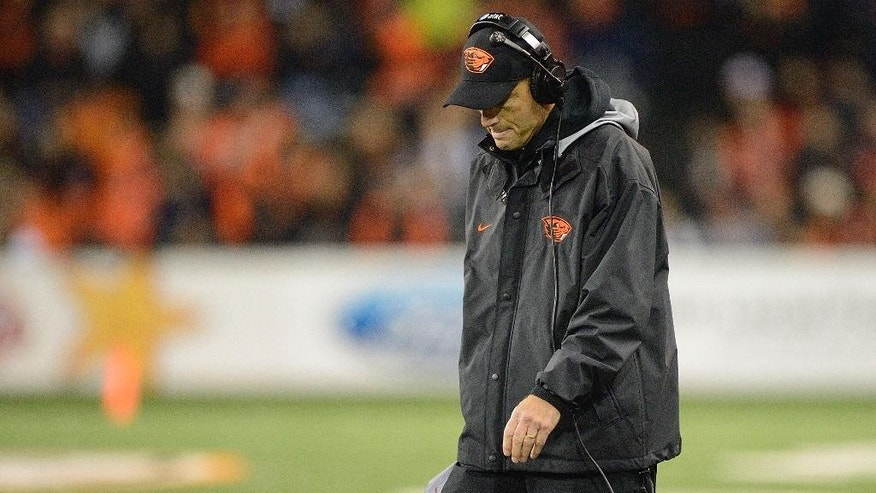 Oregon State head football coach Mike Riley walks the sidelines during an NCAA college football against California in Corvallis, Ore., Saturday, Nov. 1, 2014. California beat Oregon State 45-31. (AP Photo/Troy Wayrynen)